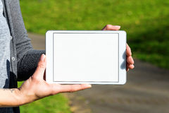 White blank tablet held by woman Stock Images