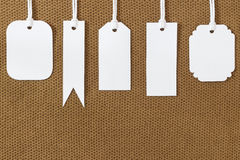 White blank tags label on fabric texture Stock Image