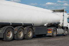 White blank tank truck, rear view, one object on road Royalty Free Stock Photography