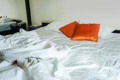 White blanket and white pillow, orange pillow. stock images