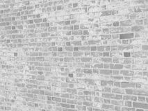 White bleached brick wall texture. Brick wall grunge texture with stains of white paint with copy space for your design stock images