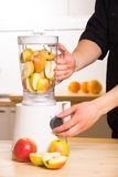 White blender with apples on a wooden table. Royalty Free Stock Photo