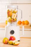 White blender with apples on a wooden table. Stock Image