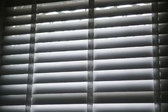White blind shade curtain and shadow Stock Photo