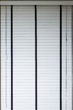 White blinds on window, design interior of bedroom Royalty Free Stock Images