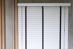 White blinds on window, design interior of bedroom Royalty Free Stock Photos