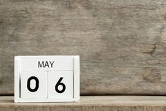 White block calendar present date 6 and month May on wood background royalty free stock images