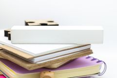 White block on stack of books, it can write for various occasions. Image use for business background concept.  Royalty Free Stock Photo