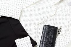 White blouse and black skirt, top view, close up, trendy outfit stock photo
