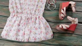 White blouse and wedge sandals. stock footage
