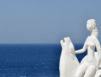 White and blue. White statue with Mykonos sea as background Stock Photos