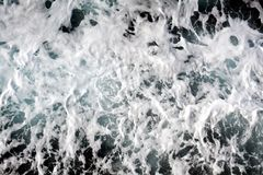 White blue agitated various waves, rocks, background. White blue gray blue sea agitated various waves, natural background in white, gray hues in Elba island Royalty Free Stock Images