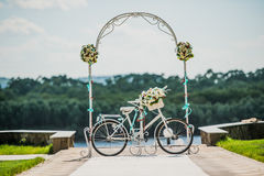 White and blue arch decorated with flowers bycicle, wedding registration outdoors Stock Photography