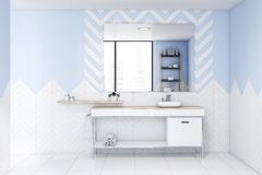 White and blue bathroom interior with sink royalty free stock image