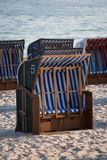 White and blue beach chairs on sand. Stock Photography