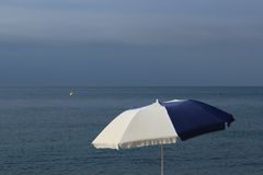 White and blue beach umbrella Royalty Free Stock Photo