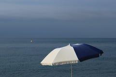 White and blue beach umbrella Royalty Free Stock Photo