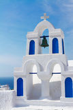 White with blue belfry, Santorini island, Greece. White and blue church belfry at sunny day,  Santorini island, Greece Royalty Free Stock Image