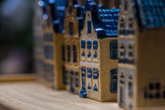 White and blue ceramic souvenir miniature of houses on wood background Stock Photography