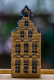 White and blue ceramic souvenir miniature of houses on wood background Royalty Free Stock Image