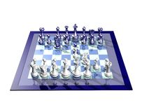 WHITE AND BLUE CHESSBOARD. Reflecting chessboard with blue and white opponents Royalty Free Stock Photography
