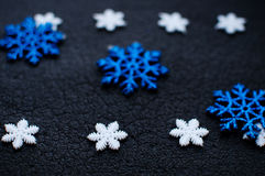 White and blue Christmas snowflakes decoration on black textured background. White and blue Christmas snowflakes decoration on black textured background close Royalty Free Stock Photography