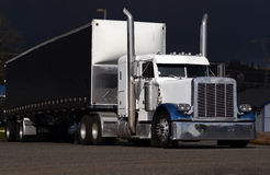 White and blue classic semi truck Royalty Free Stock Photo