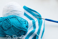 White and blue cotton yarn and crochet hook Royalty Free Stock Image