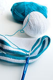 White and blue cotton yarn and crochet hook Royalty Free Stock Photos