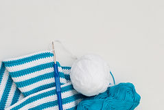 White and blue cotton yarn and crochet hook Stock Photography
