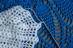 White and blue crochet and hook Royalty Free Stock Photo