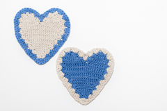 White and Blue Crochet Knitted Hearts Royalty Free Stock Images