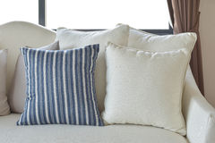 White and blue decorative pillows on a casual sofa in the living room Royalty Free Stock Images