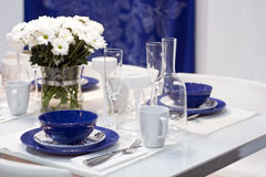 White and blue dining table Stock Photo