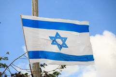 White and blue flag of Israel over the sky Royalty Free Stock Photo