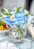 White and blue flowers in a glass Stock Image