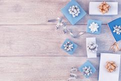 White and blue gift boxes with beautiful bows, decorative ribbons. Christmas composition with place for text, copy space royalty free stock photo