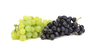 White and blue grape bunches. Royalty Free Stock Photography
