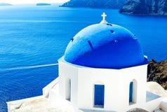 White and Blue Greek church in Santorini Oia, Greek Islands, Greece. Wonderful White and Blue Greek church against blue Aegean Sea in Santorini Oia, Greek Stock Photo
