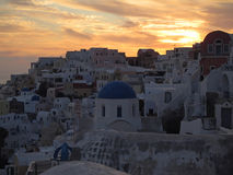 White and blue Greek Island Style architecture against golden evening sky at Oia village, Santorini Island Stock Images