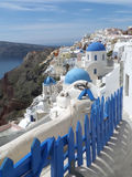 White and blue Greek Islands traditional churches architecture at Oia village, Santorini island Royalty Free Stock Photography
