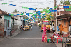 White, blue, green flags. Street decoration in Kochi (Cochin), Kerala, India Stock Image
