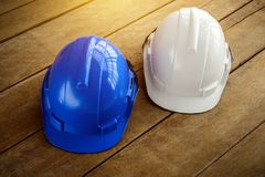 White, blue hard safety helmet construction hat for safety proje Stock Photography