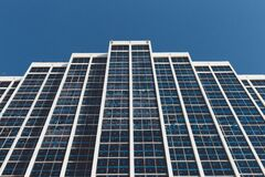 White and Blue High Rise Building Under Blue Sky during Daytime Stock Photography