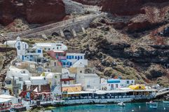 White and Blue Houses Beside Body of Water Stock Photography