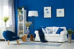 White and blue interior. White and blue decor of cozy living room interior Royalty Free Stock Photo