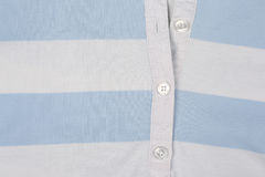 White blue knit shirt with buttons closeup. The white blue knit shirt with buttons closeup Royalty Free Stock Photography