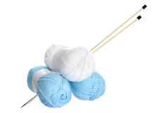 White and blue knitting yarn and needles Royalty Free Stock Image