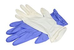 White and blue latex gloves closeup. White and blue latex gloves isolated on white background royalty free stock images