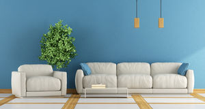 White and blue living room. Modern living room with white sofa and blue wall - 3d rendering Stock Photo